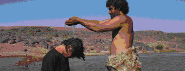 Jesus es bautizado en el Rio Jordan por Juan el bautista